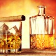 Glass of whiskey with ice flavored cigar — Stock Photo #54402739