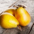 Three ripe juicy yellow pears — Stok fotoğraf #57670885