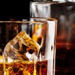 Fragment of a glass of whiskey with ice — Stock Photo #62336931