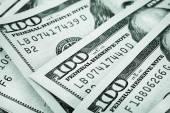 Background of the folded fan of hundred-dollar bills — Stock Photo