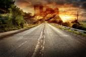 Asphalt road receding into the distance — Stock Photo