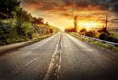 Asphalt road receding into a distance — Stock Photo