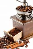 Coffee grinder with coffee beans and cinnamon — Stock Photo