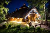Fairy-tale wooden house illuminated lights — Stock Photo