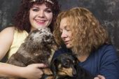 Women with dogs — Stock Photo