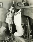 Girl with large Christmas stocking — Stockfoto