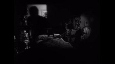 Shadow moving towards woman sleeping — Stock Video