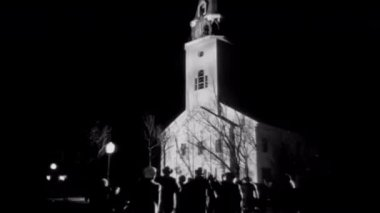 Crowd rushing to church at night — Stock Video