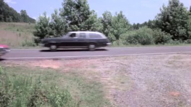 Car driving off country road — Vídeo stock