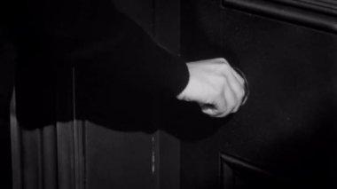 Woman trying to open locked door — Stock Video