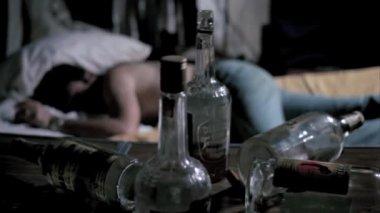 Empty liquor bottles on table — Stock Video