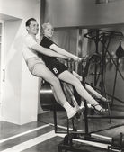 Man and woman Training at the gym — Stock Photo