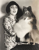 Woman showing off her pomeranian — Stock Photo