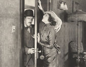 Woman pushing door — Stock Photo