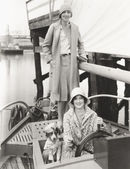 Women out sailing with their mascot — Stock Photo