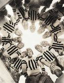 Team standing in circle — Stock Photo