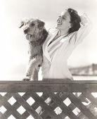Woman posing with her Airedale — Stock Photo
