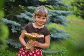 Girl with mushroom — Stock Photo