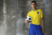 Young Brazilian Footballer in Kit Holding Football — Stock Photo