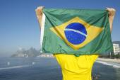 Brazilian Football Player Holding Flag at the Sea — Photo