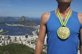 Gold Medal Athlete Standing Rio Skyline — Stock Photo