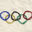 Carnival Beads Olympic Rings in the Sand Rio — Stock Photo #73066505