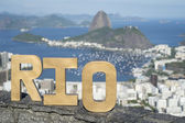 Rio Message in Gold Numbers City Skyline — Stock Photo