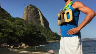 Gold Medal RIO Athlete Standing at Sugarloaf Mountain — Stockvideo