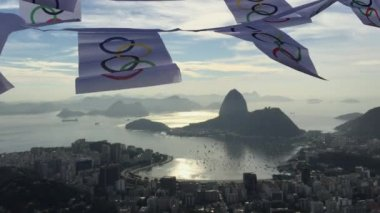 Olympic Flag Bunting Waving at Rio de Janeiro Skyline Overlook — Stock Video