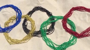 Carnival Beads Olympic Rings in the Sand Rio — Stock Video