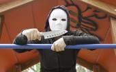 Murderer in mask Park — Stock Photo