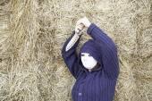 Murderer in haystack — Stock Photo