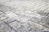 Black floor tiles — Stock Photo