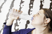 Girl cold water bottle — Stock Photo