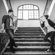 Boyfriends on stairs — Stock Photo #73195545