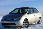 Toyota Prius V. Hybrid car on the background of nature. — Stock Photo