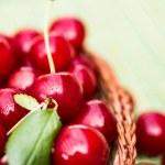 Organic Cherries in a Basket — Stock Photo #69082763