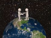 3d men shaking hands on the earth. 3d render — Stock Photo