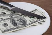 Dollar bank note money in the white plate — Stock Photo