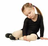 Little Girl dancer sits on White Background — Stock Photo