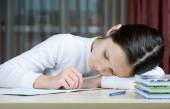 Young schoolboy girl does his homework — Stockfoto
