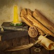 Old books, candle and feather amulet with ink — Stock Photo #75418481