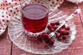 Cherry compote with berries — Stock Photo