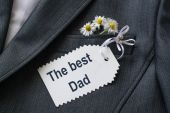 Surprise for the dad in his jacket pocket: congratulations and d — Stock Photo