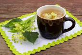 Curative tea with lime blossom — Stock Photo