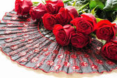 The bouquet of red roses on a folding fan — Stock Photo
