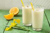 Fresh homemade milkshake with ice cream, orange juice and nutmeg — Stock Photo