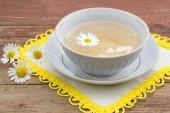 Herbal medicine: curative tea with chamomile — Stock Photo