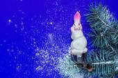 Vintage Christmas Toy hare on a branch with artificial snow — Stockfoto