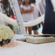 Holy bible and wedding bouquet at outdoor wedding on beach — Stock Photo #55274127